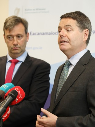 Paschal Donohoe (right) said Michael D'Arcy (left) was heading to London for the insurers talks