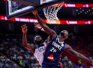 Jay Brown of USA and Mathias Lessort of France in action during today's quarter-final.