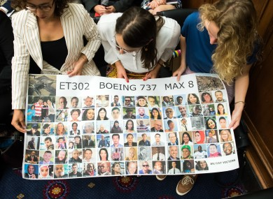 Hearing attendees hold a sign honoring the victims of the Ethiopian Airlines 302 crash during a House Transportation Subcommittee hearing on the Boeing 737 MAX on Capitol Hill in Washington, D.C. on June 19, 2019.
