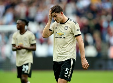 Manchester United's Harry Maguire appears dejected after the final whistle.