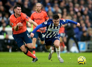 Connolly and Michael Keane battle for the ball.