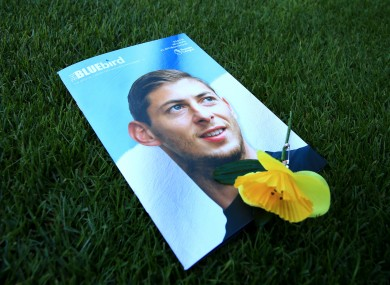 A Cardiff City match programme featuring an image of the late striker.
