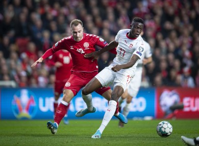 Denmark's Christian Eriksen, left, and Switzerland's Denis Zakaria challenge for the ball.