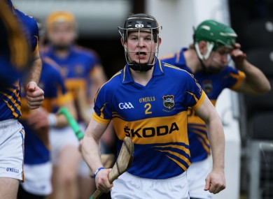 Donagh Maher running onto the pitch for Tipperary in 2012.
