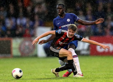 Evan Ferguson with Chelsea's Kurt Zouma in a friendly game in July.