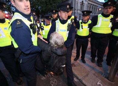 Gardaí remove demonstrators during an Extinxtion Rebellion protest in Dublin this evening