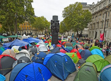 Extinction Rebellion (XR) protesters camp in tents around the Monument to the Women of World War II on Whitehall in Westminster.