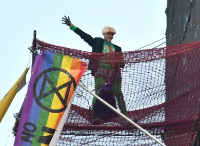 An Extinction Rebellion protester who scaled the scaffolding surrounding Big Ben at the Houses of Parliament, Westminster