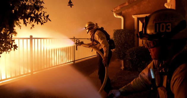 Thousands flee homes as wildfire rages on edge of Los Angeles