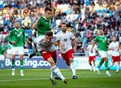 Seamus Coleman battles with Gia Grigalava during yesterday's game.