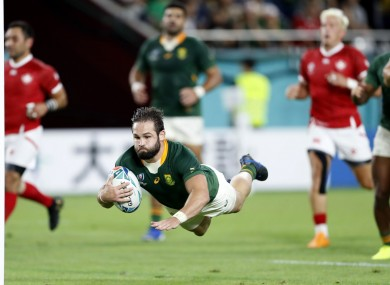 South Africa's Cobus Reinach dives to the line.