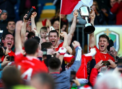 Niall Carty and Ronan Daly lift the cup after Padraig Pearses triumphed.