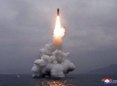 An underwater-launched missile lifts off in the waters off North Korea's eastern coastal town of Wonsan. Photo provided by the North Korean government.