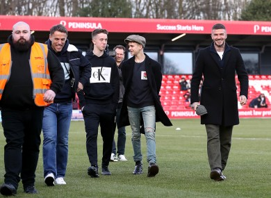 Harvey Neville (third from left) with Dad Phil, Romeo Beckham and David Beckham at a recent Salford City game.