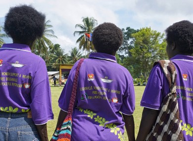 Bougainville residents wearing t-shirts promoting a peaceful referendum.