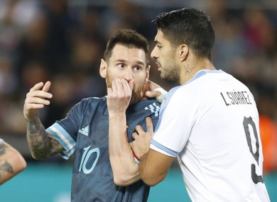 Lionel Messi and Barcelona team-mate Luis Suarez share a few words during the game.