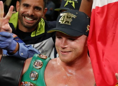 Saul 'Canelo' Alvarez celebrates after becoming a four-weight world champion.