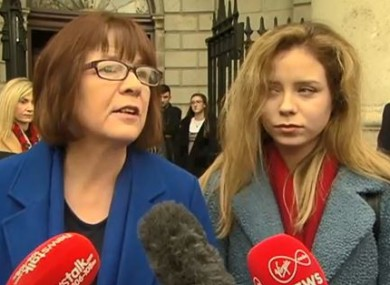 Aoife Bennett (R) with her mother Mary outside the High Court yesterday.