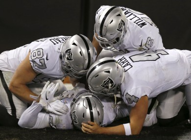 Raiders running back Josh Jacobs celebrates with teammates after scoring against the Los Angeles Chargers.
