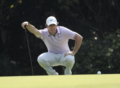 McIlroy sizes up a putt in Shanghai.