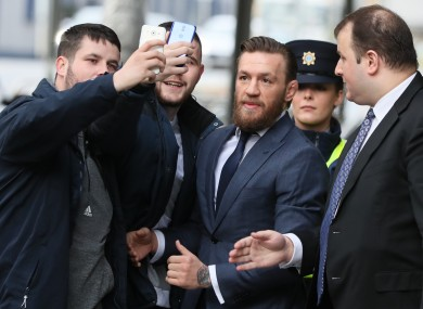 Members of the public outside the court today with McGregor.