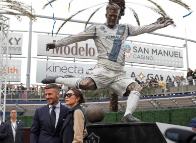 David Beckham and his wife, Victoria, with his LA Galaxy statue.