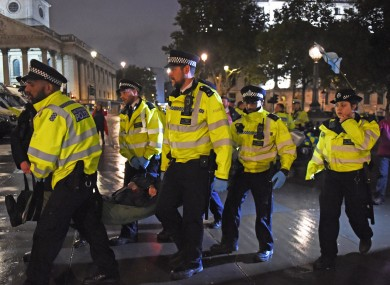 Police remove an Extinction Rebellion protester from Trafalgar Square in London last month