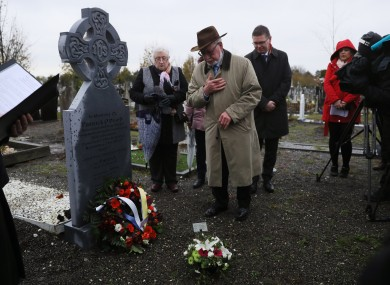 Liam Dinneen, from Skerries, at the grave of his grand uncle Patrick OÕDowd, during a ceremony at Glasnevin cemetery.