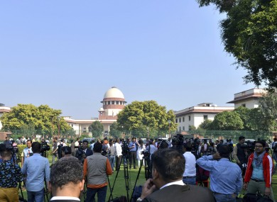 Crowds gather outside the Supreme Court in New Delhi.