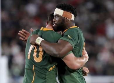 Kolisi embraces Handre Pollard after the game.