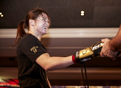 Katie Taylor shares a joke with trainer Ross Enamait.
