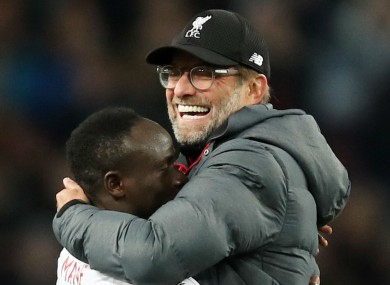 Jurgen Klopp celebrates victory at Villa Park with Sadio Mane.