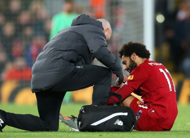 Salah receives treatment during Liverpool's victory over Man City.