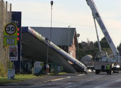 A recovery crane removing the forecourt roof onto the road following a raid at Carlisle's filling station on Belfast Road, Ballynahinch