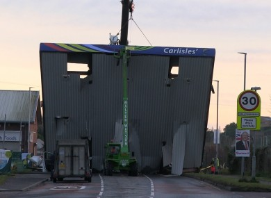 A crane removing the forecourt roof of Carlisle's filling station following an attempted ATM robbery.