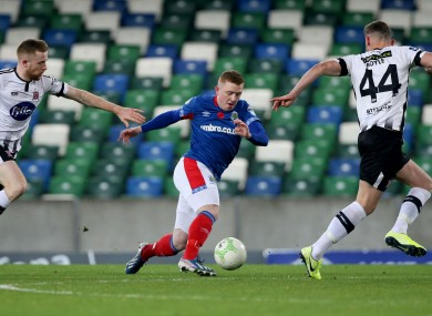Linfield's Shayne Lavery tries to find a way through Sean Hoare and Andy Boyle of Dundalk.