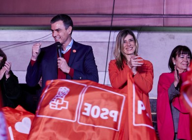 Spanish Prime Minister Pedro Sanchez thanks his supporters as they wave flags outside of the PSOE headquarters in Madrid