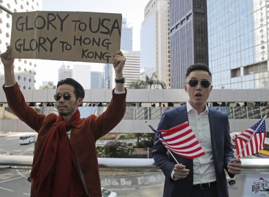 Protesters hold American flags during demonstration in Hong Kong.
