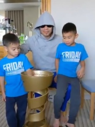 Donaire's sons enjoy their time with the Muhammad Ali Trophy.