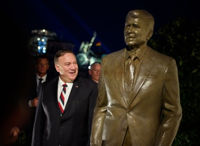 US Secretary of State Mike Pompeo pictured next to a statue of former US President Ronald Reagan at the US Embassy in Berlin today.