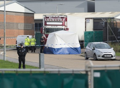 olice officers work at the scene where 39 bodies were found in a shipping container at Waterglade Industrial Park in Essex, Britain