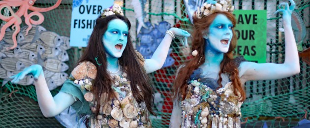 Leah Rossiter (left) and Ceara Carney, dressed as mermaids, join members of the Irish Wildlife Trust and Extinction Rebellion Ireland protesting outside Leinster House