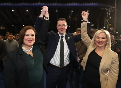 John Finucane celebrates with Mary Lou McDonald and Michelle O'Neill.
