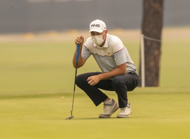 Ryan Chisnall wears a face mask during the first round of the Australian Open.