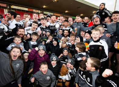 Kilcoo players and fans celebrate yesterday's Ulster final victory.