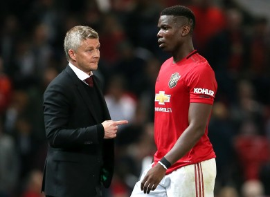 Ole Gunnar Solskjaer and Paul Pogba pictured during Manchester United's Carabao Cup game against Rochdale in September.