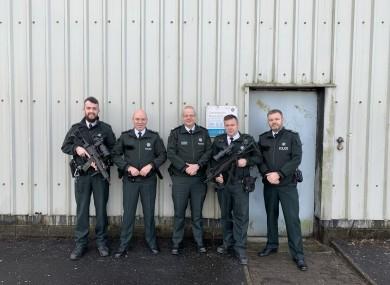 PSNI chief constable Simon Byrne, centre, alongside officers in Crossmaglen