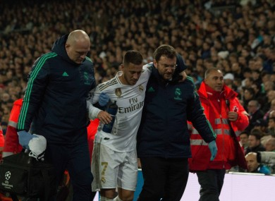 Eden Hazard is helped off the field by medical staff during the Champions League game with PSG.