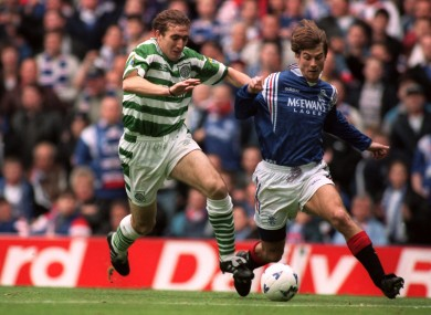 Alan Stubbs (left) battles for possession with Brian Laudrup.