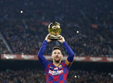 Messi is given his latest Ballon D'Or award ahead of kick-off.